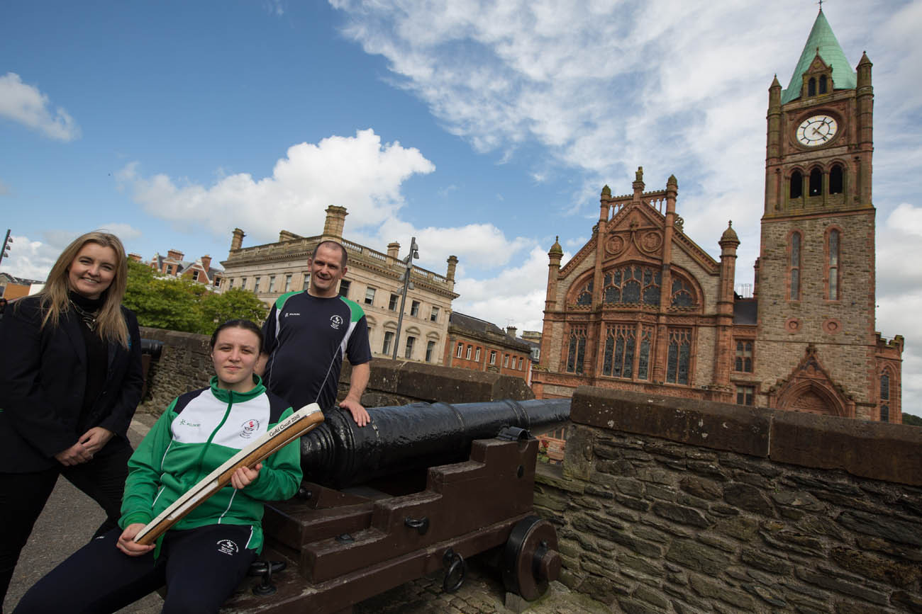 The Queen's Baton, carried by (left to right) Dr. Lisa Bradley (Manchester 2002, silver medal, judo), Kirsty Strouts McCallion (silver medal CYG Bahamas 2017, judo) and Jim Toland (coach of Judo), on the City Walls, outside Guildhall, in Derry/Londonderry