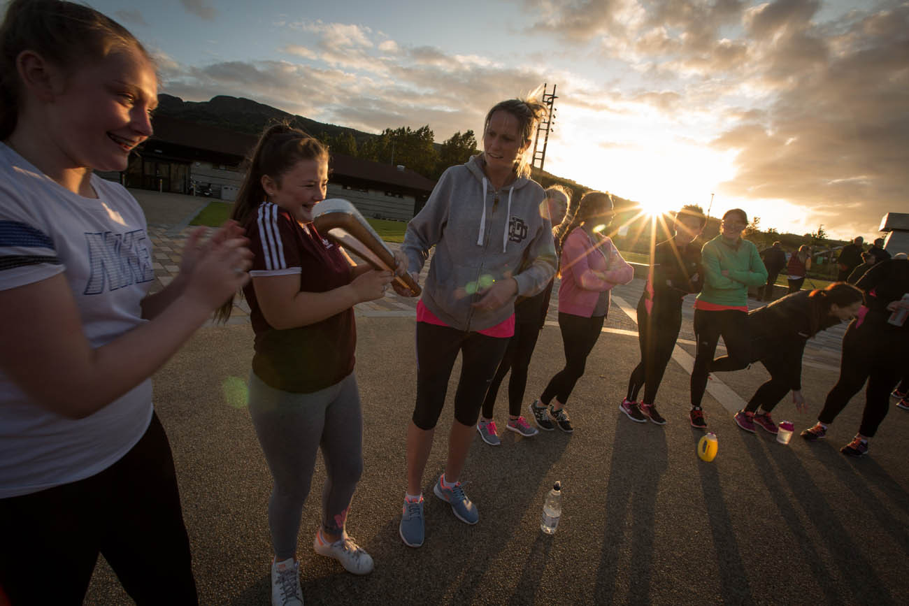 The Queen's Baton carried by participant runners of the 'Couch to 5km' running program, at the Valley Leisure Centre, in Newton Abbey, in Northern Ireland, on 29 August 2017.