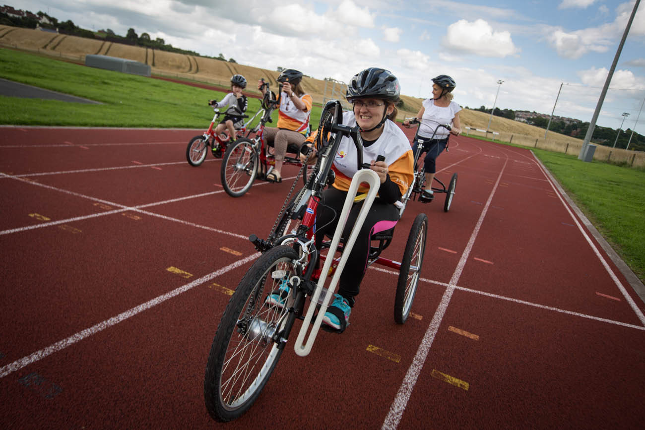 The Queen's Baton was received at St. Colman's Sports Complex, and was carried on the track by users of the mobility tricycles, in Newry, in Northern Ireland, on 30 August 2017.