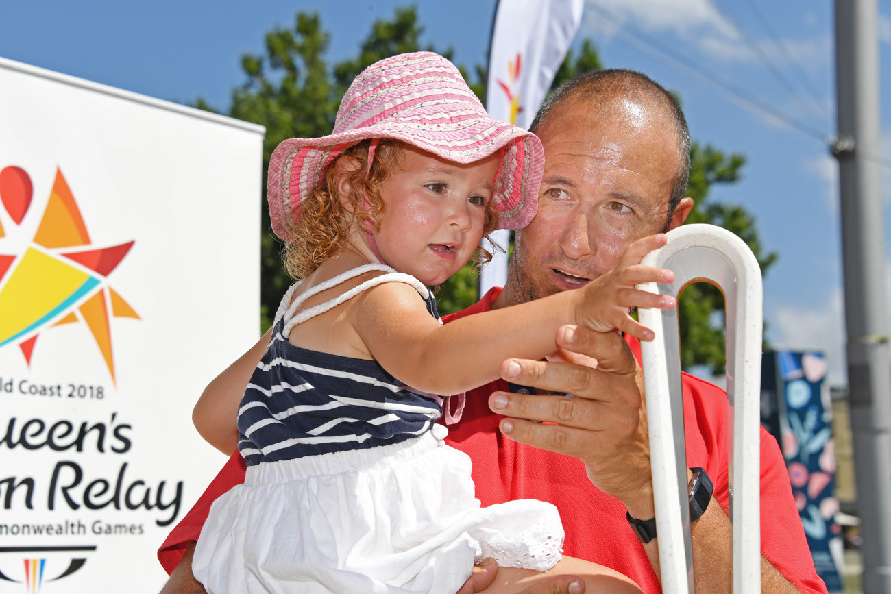 A father and his daughter with the Baton at the Taste of Tasmania