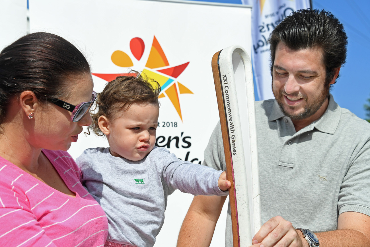 A young family with the Queen's Baton in Hobart