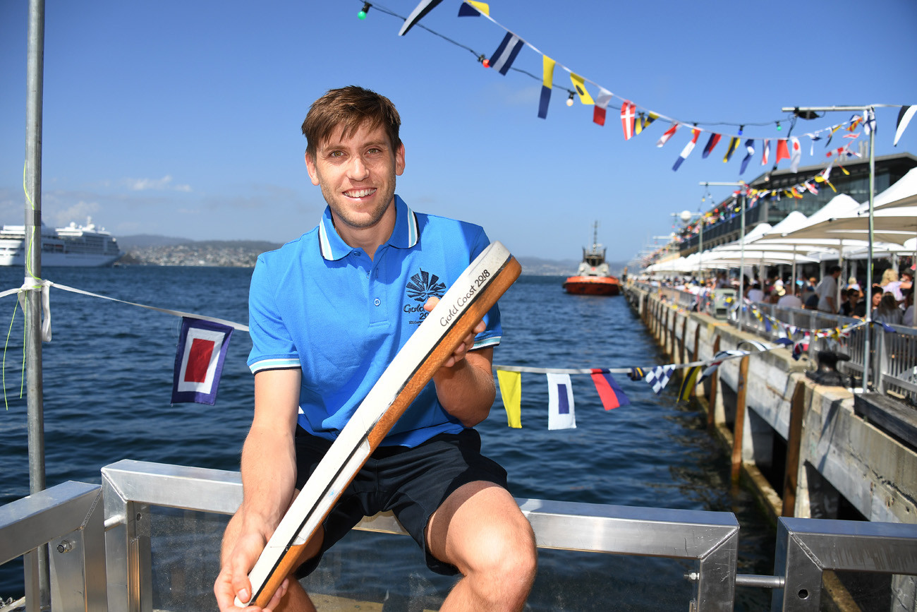 Australian hockey player Eddie Ockenden with the Queen's Baton at Princes Wharf