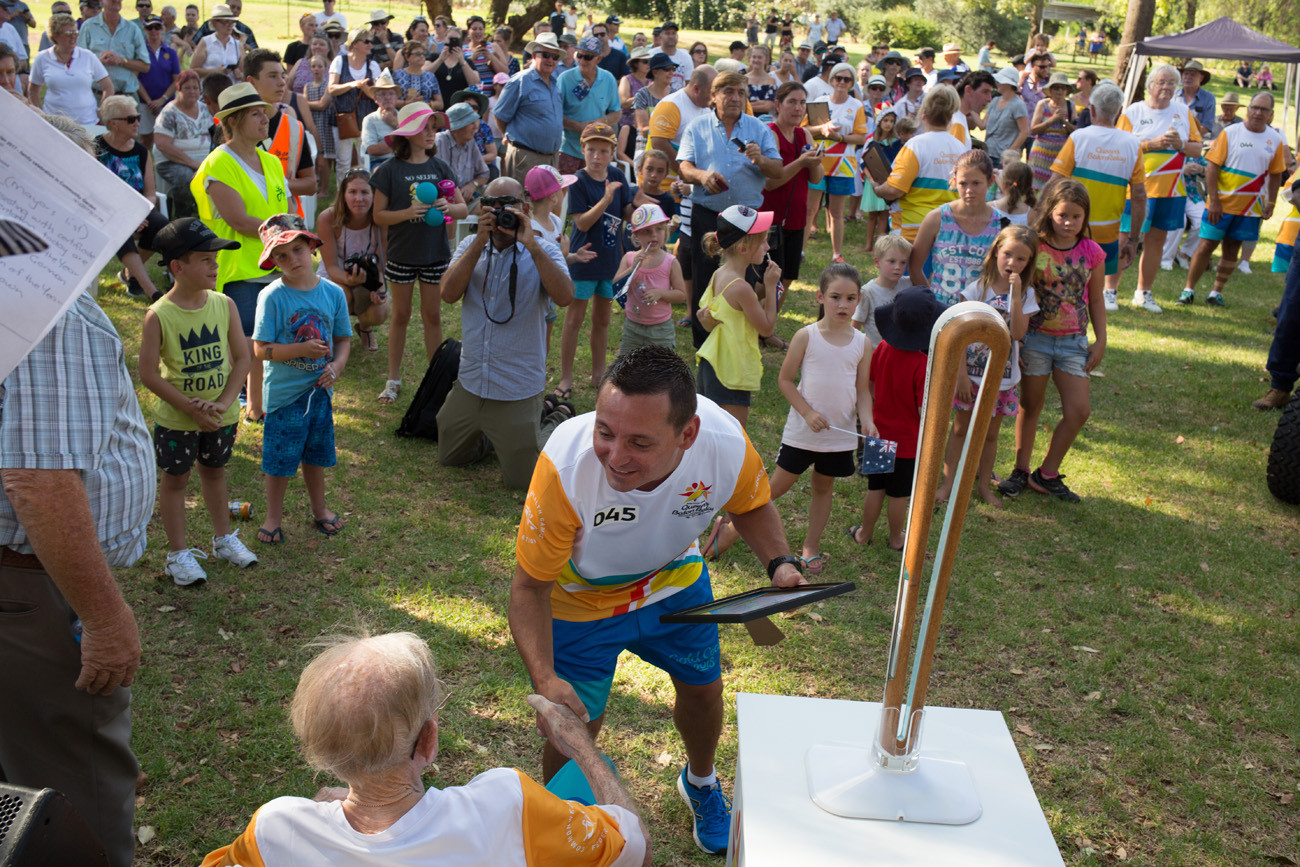 The Queen's Baton received by batonbearers and members of the public at the end of day celebrations in Griffith