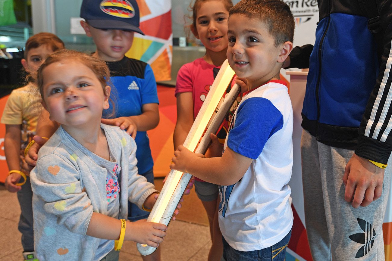 Young kids with the Queen's Baton
