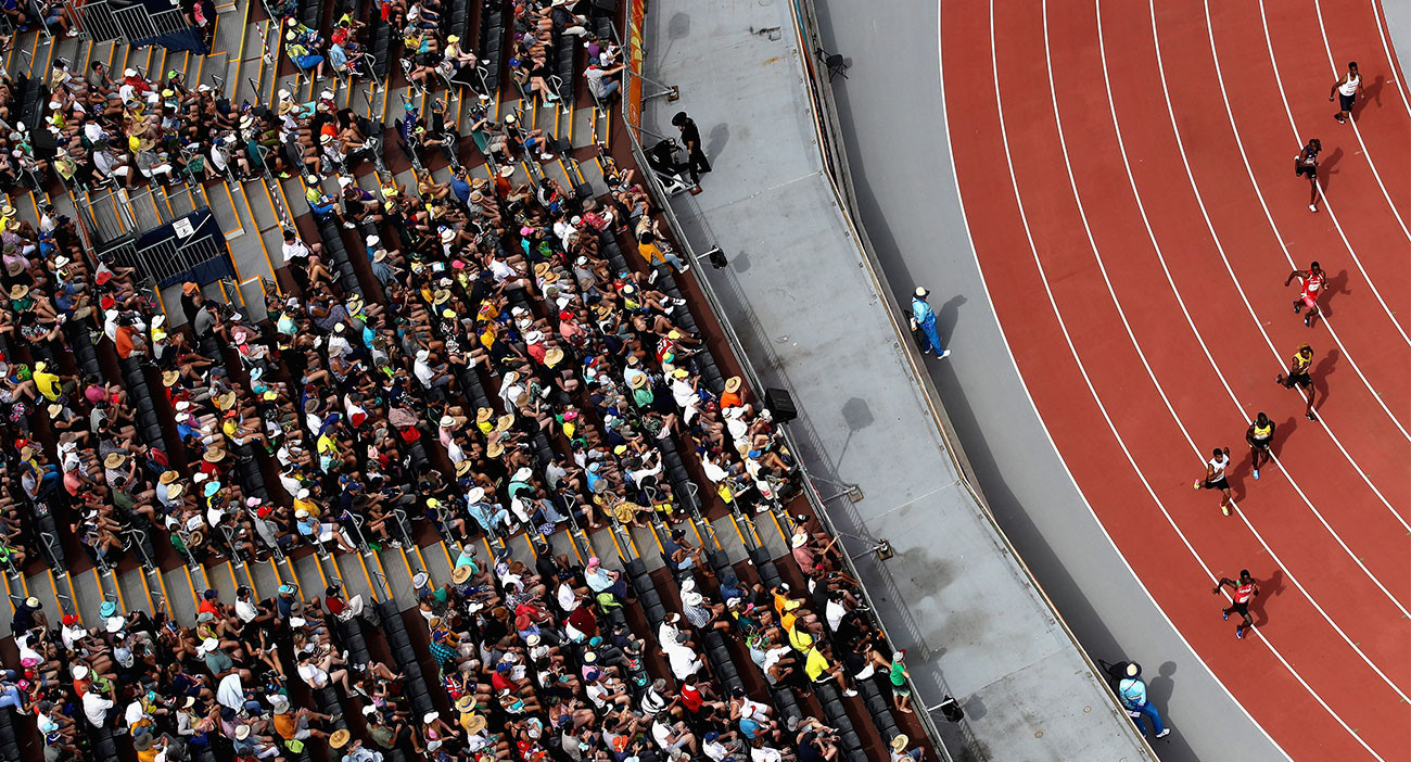 Athletes compete in the men's 200 metres heats during the Athletics at Carrara Stadium.