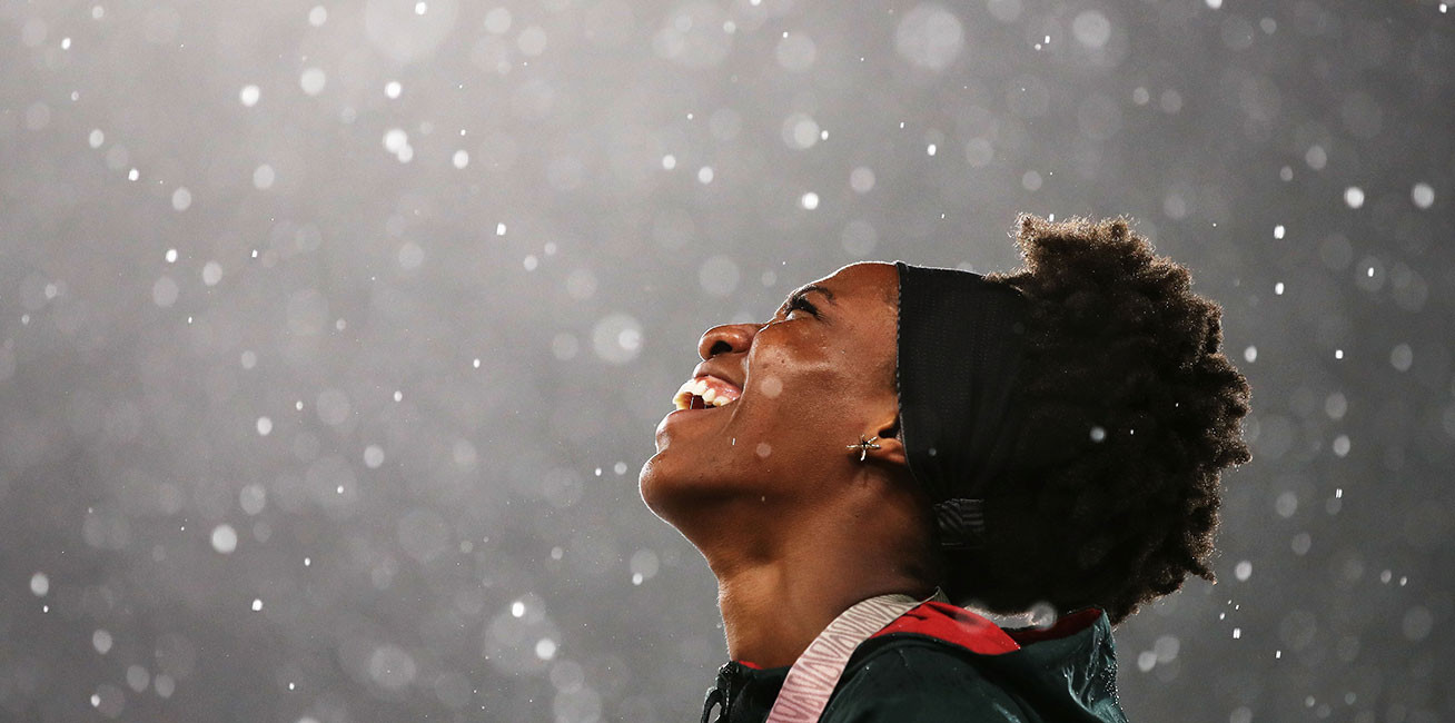 Bronze medalist Thea Lafond of Dominica during the medal ceremony for the women's Triple Jump during the Athletics.