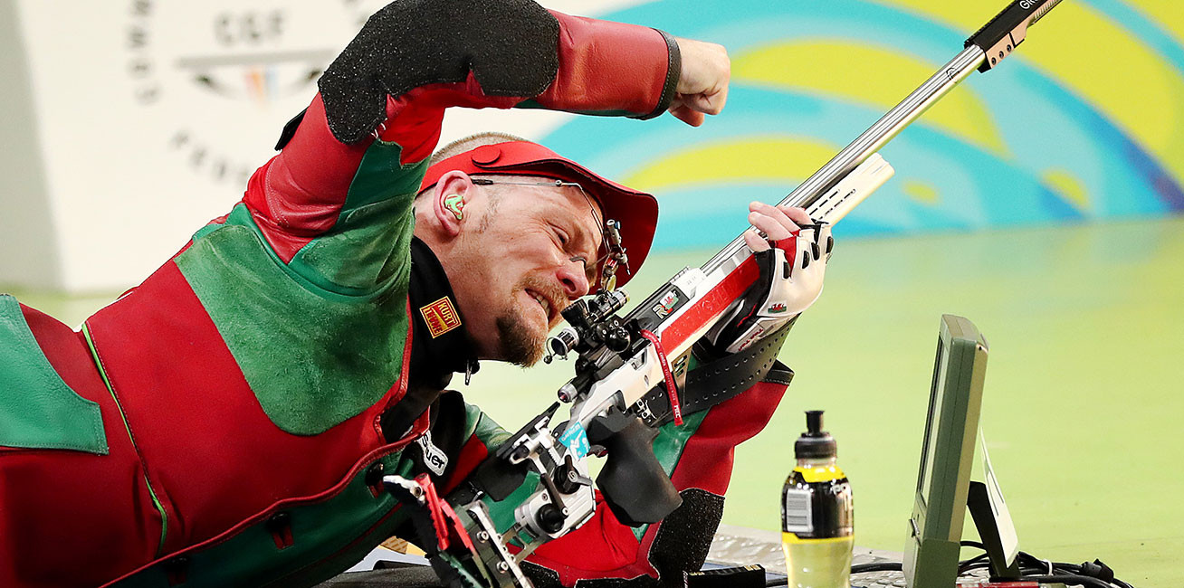 David Phelps of Wales celebrates winning gold during Shooting men's 50m Rifle Prone at Belmont Shooting Centre.