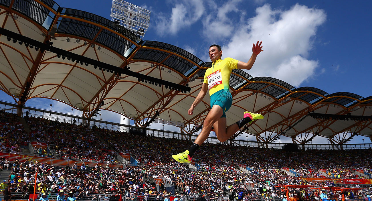 Fabrice Lapierre of Australia competes in the men's Long Jump qualification during the Athletics at Carrara Stadium.