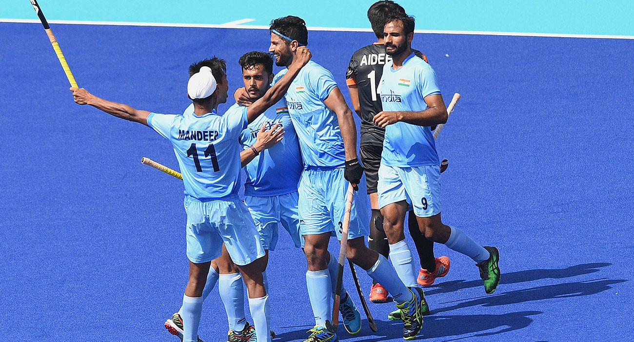 Harmanpreet Singh of India celebrates scoring a goal with team mates during the Hockey men's pool B match between India and Malaysia.