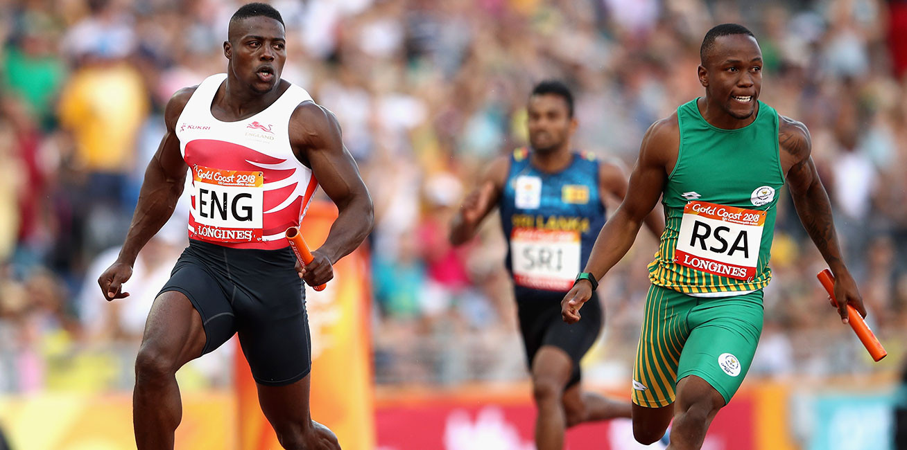 Harry Aikines Aryeetey of England crosses the line to win gold ahead of Akani Simbine of South Africa in the men's 4x100m relay final.