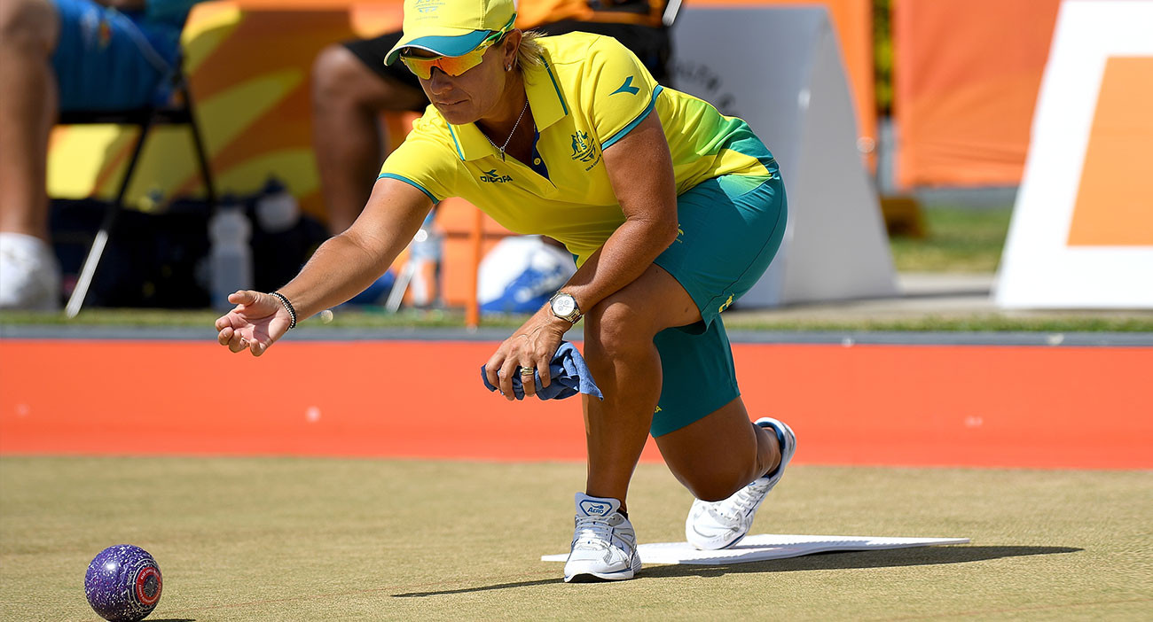Karen Murphy of Australia bowls in her doubles match with Kelsey Cottrell against Niue at the Broadbeach Lawn Bowls Club.
