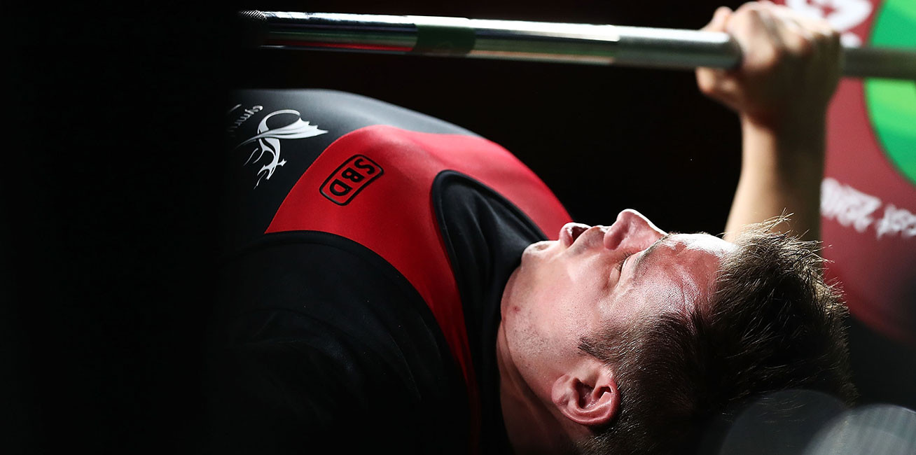 Nathan Stephens of Wales competes in the men's Lightweight final during the Para-Powerlifting at Carrara Sports and Leisure Centre.