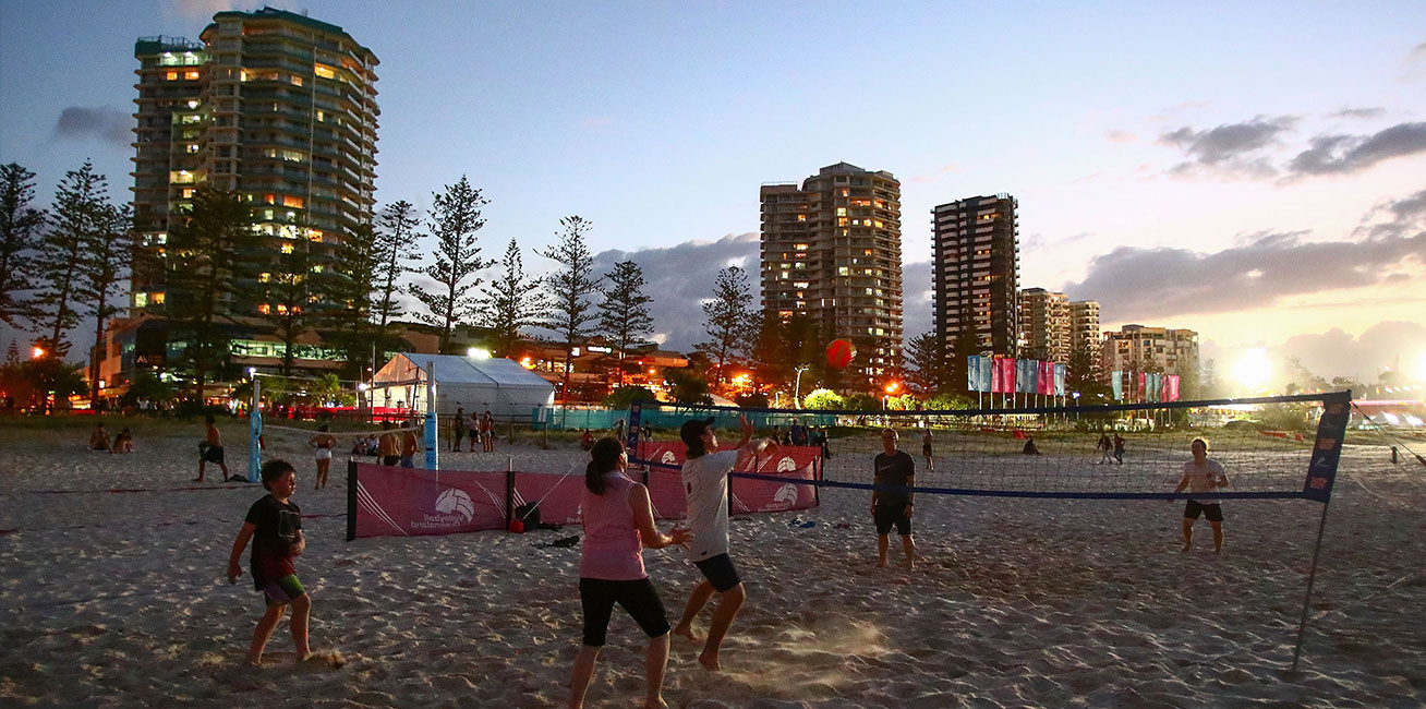 People play beach volleyball outside the Coolangatta Beach Volleyball Stadium.