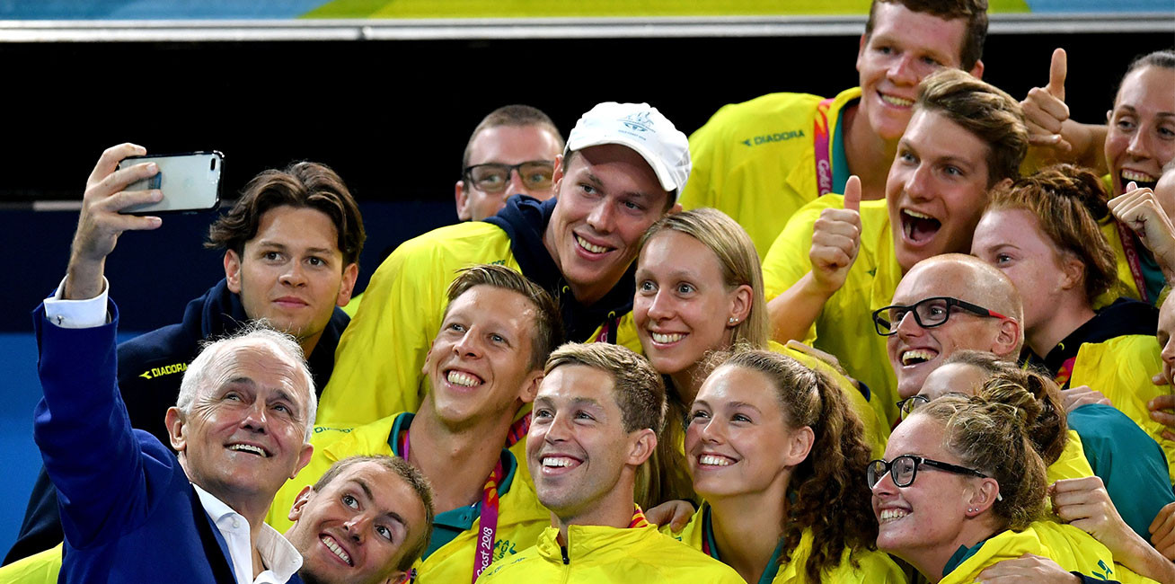 Prime Minister of Australia Malcolm Turnbull takes a selfie with members of team Australia at Optus Aquatic Centre.