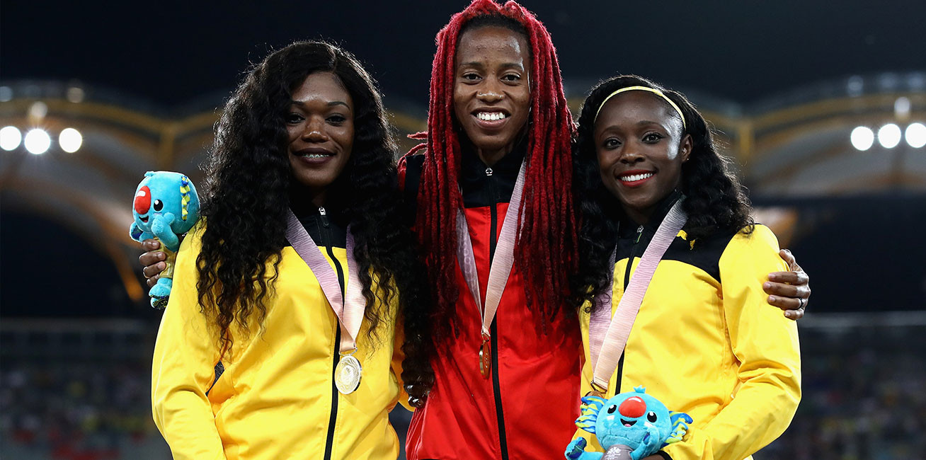 Silver medalist Christania Williams of Jamaica, gold medalist Michelle Lee Ahye of Trinidad-and Tobago and bronze medalist Gayon Evans of Jamaica in the women's 100 metre medal ceremony.