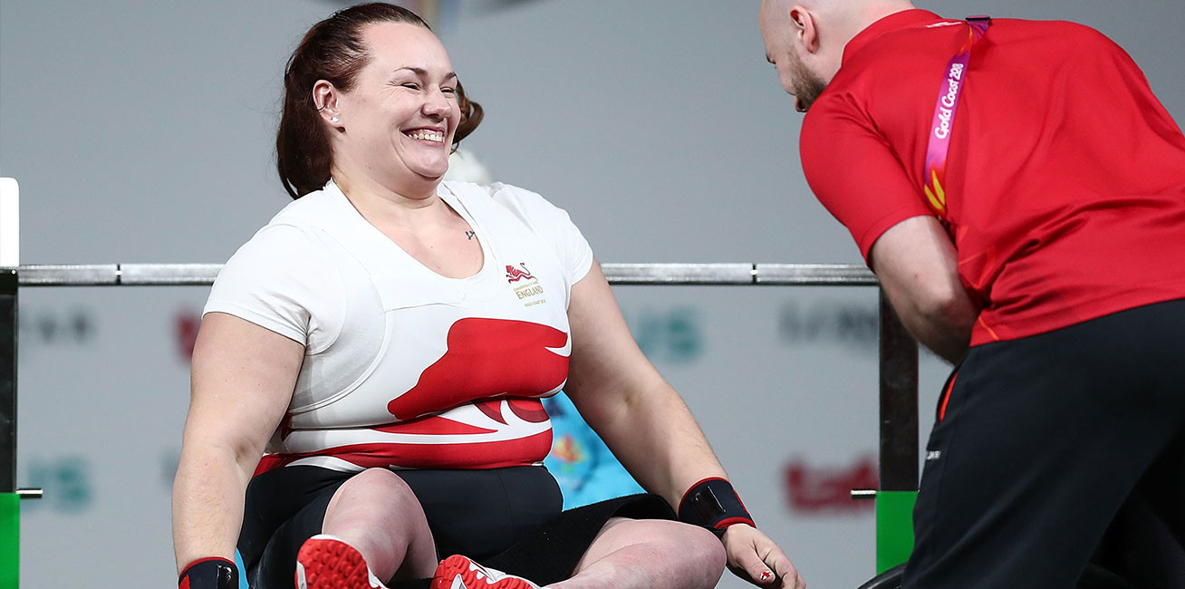 Silver medalist Louise Sugden celebrates after a successful lift in the women's Heavyweight final during the Para-Powerlifting.