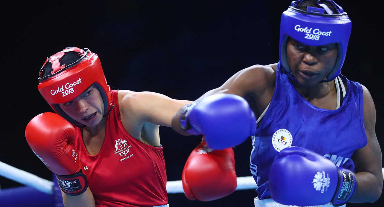 Skye Nicolson of Australia and Christelle Aurore Ndiang of Cameroon compete in the Women's 57kg quarterfinal Boxing at Oxenford Studios.