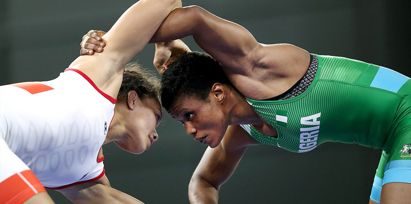 Tayla Ford of New Zealand competes against Aminat Adeniyi of Nigeria in the women's 62kg round during Wrestling.