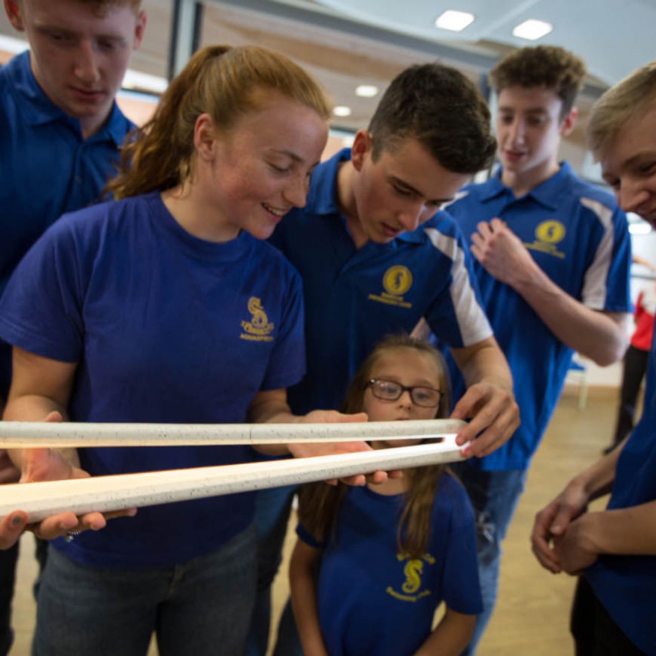 The Queen's Baton, carried by swimmers of the Bangor Swimming Team, at the Aurora Aquatic Centre, in Bangor, in Northern Ireland, on 28 August 2017.