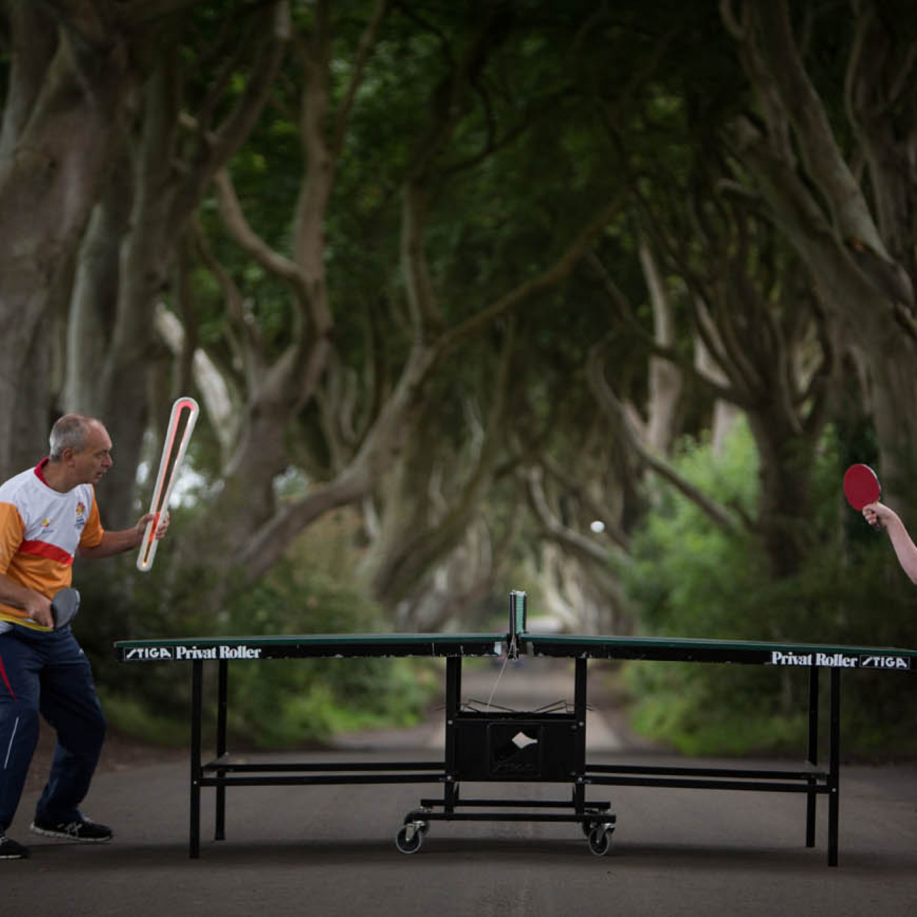 The Queen's Baton, carried by Ulster Table Tennis Club's John Fall (on left) and Colm Darragh, photographed at the Dark Hedges, known as the 'King's Road' location in the HBO's TV series Game of Thrones, in Stranocum, in Northern Ireland, on 29 August 201
