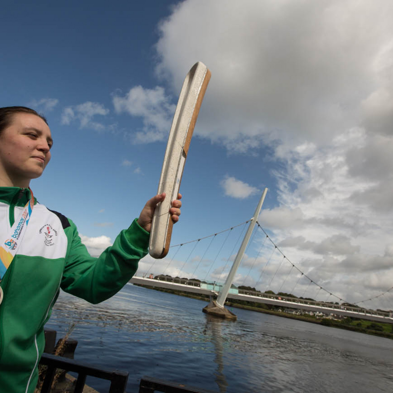 The Queen's Baton, carried by Kirsty Strouts McCallion (silver medal CYG Bahamas 2017, judo) on Peace Bridge, in Derry/Londonderry, in Northern Ireland, on 29 August 2017.