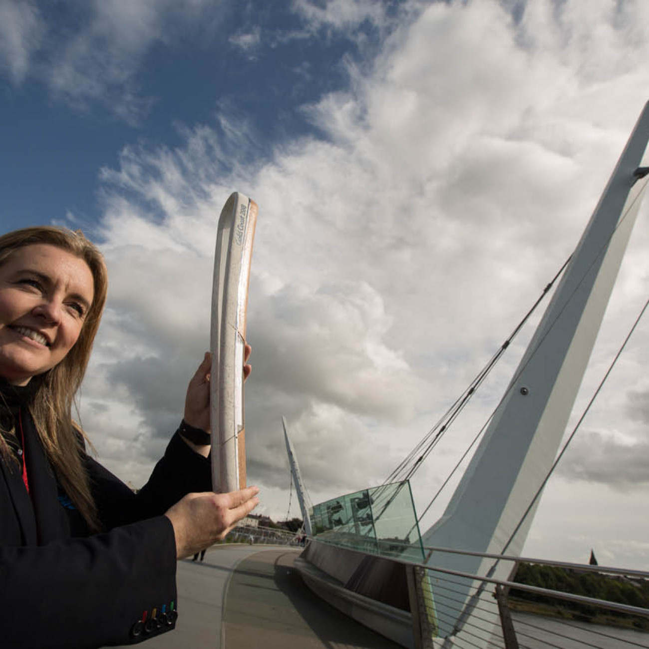 The Queen's Baton, carried by Dr. Lisa Bradley (Manchester 2002, silver medal, judo) on Peace Bridge, in Derry/Londonderry, in Northern Ireland, on 29 August 2017.