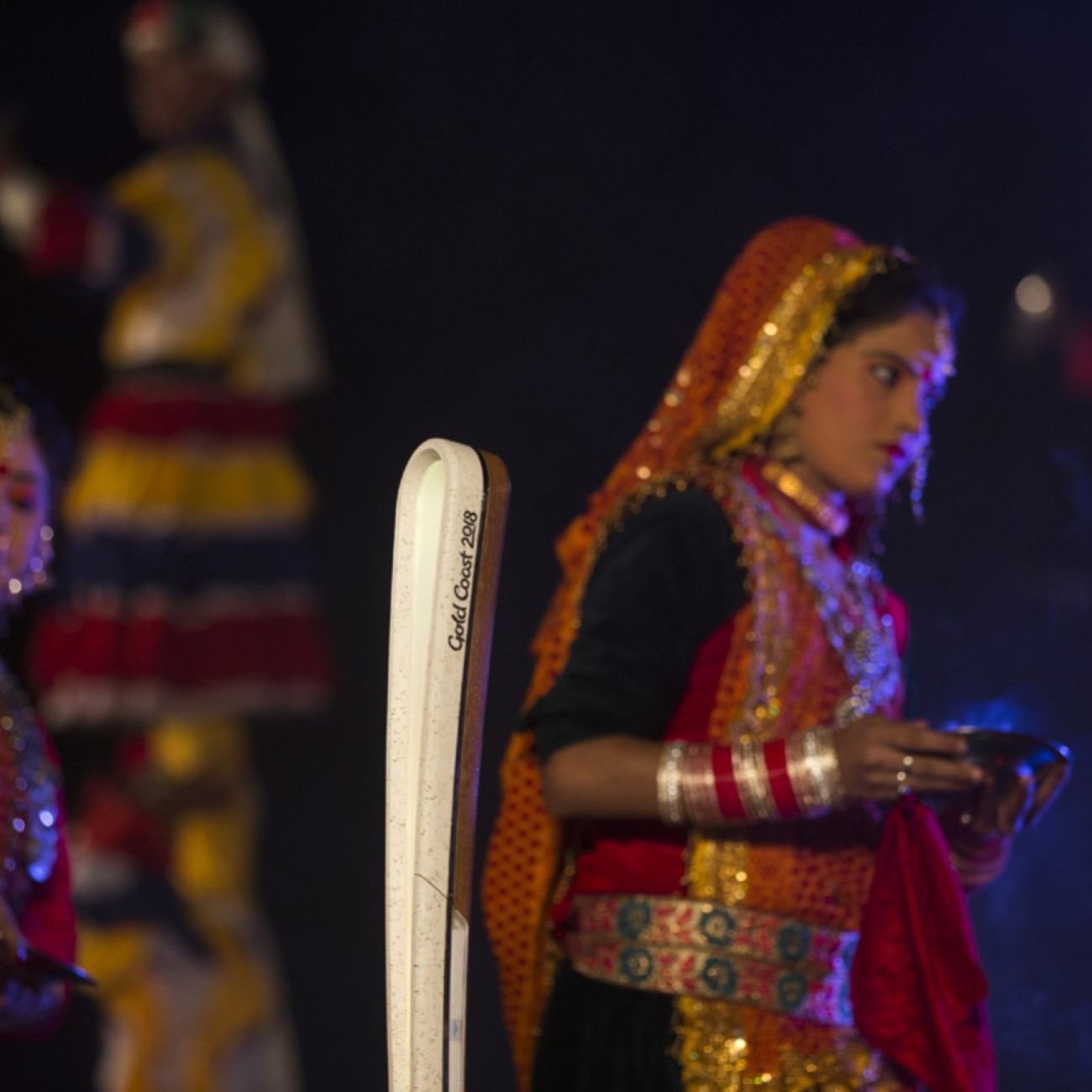 A group of performers and the Queen's Baton at a ceremony in the town of Nainital