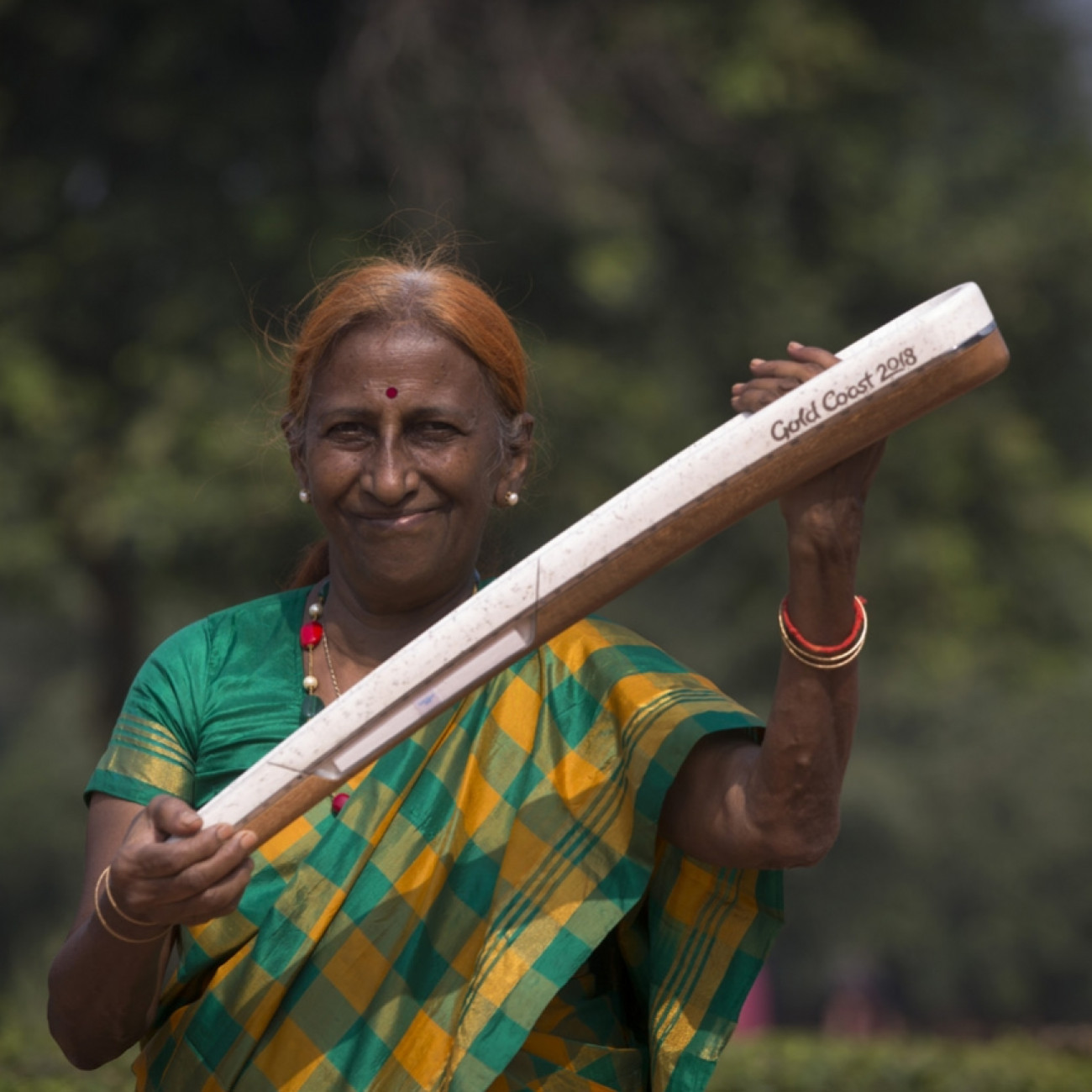 A local woman with Queen's Baton at Humayun's Tomb World Heritage site