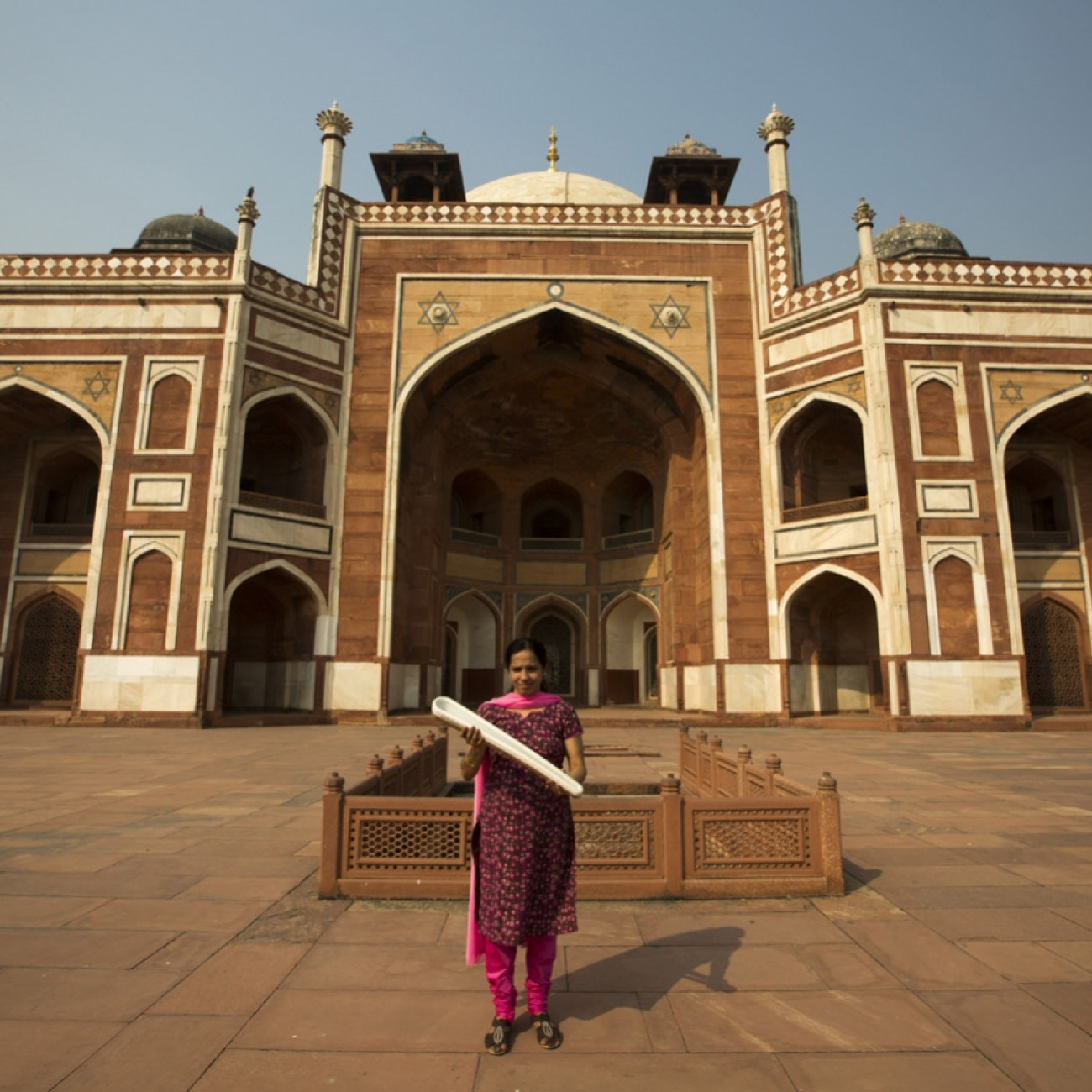 A local woman with baton at Humayun's Tomb World Heritage site