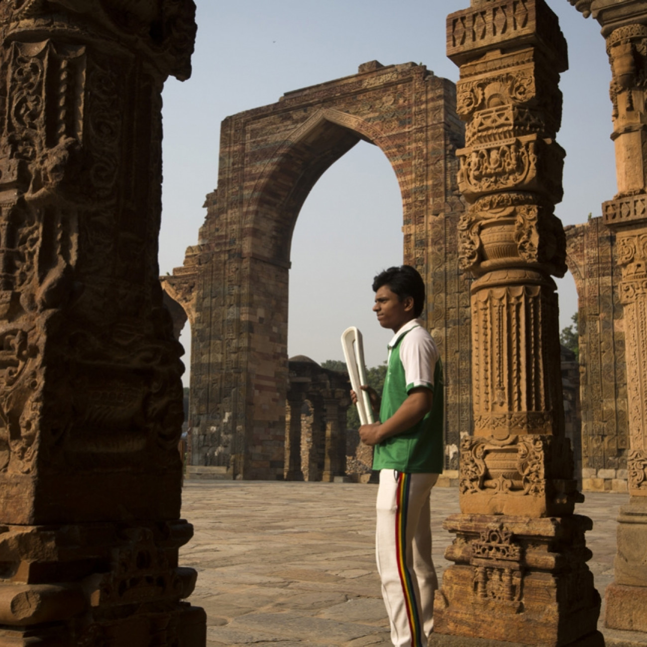 A pupil from Lal Bahadur Shastri School with the Baton at the Qutub complex World Heritage site