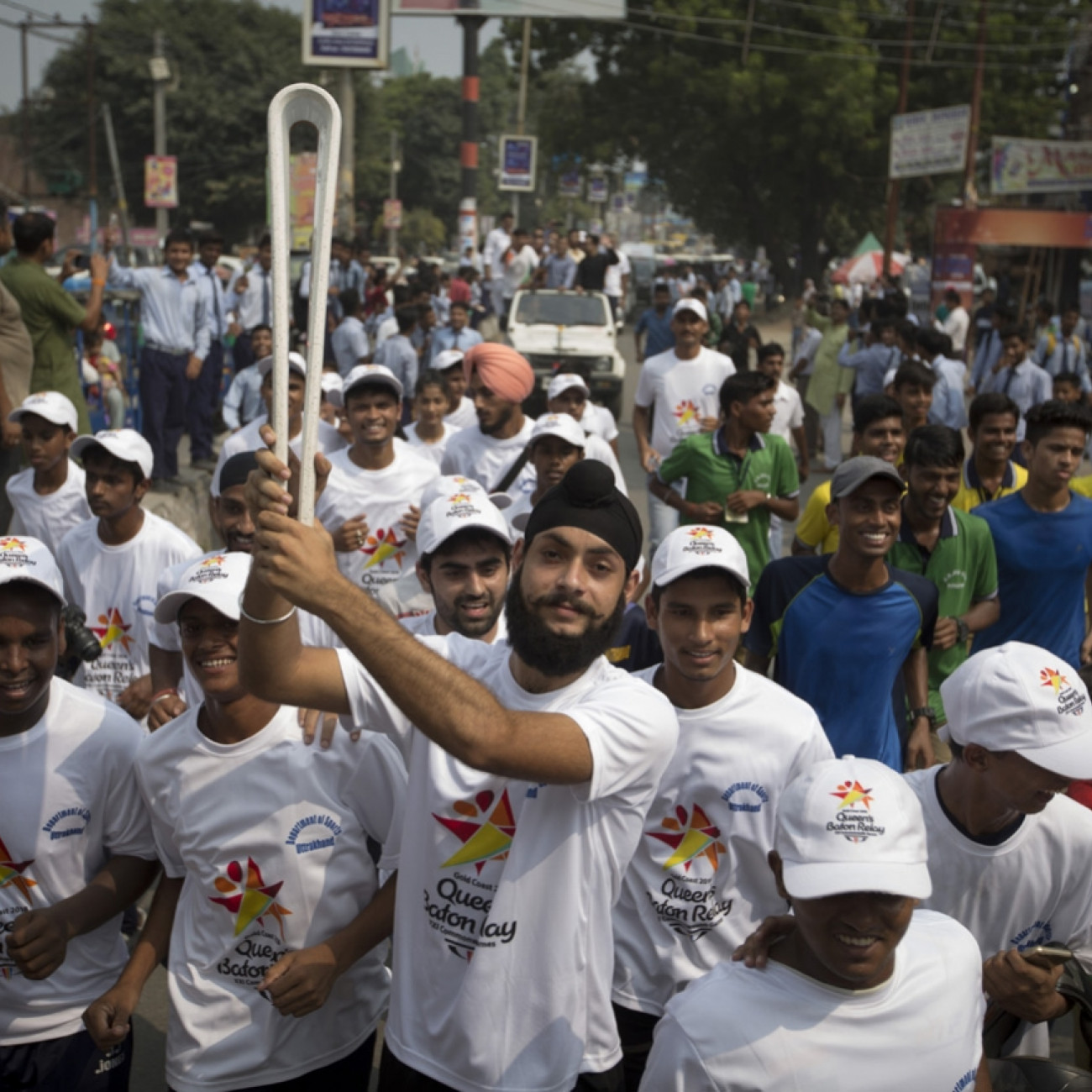 Batonbearers taking part in the Baton Relay through the streets of Rudrapur