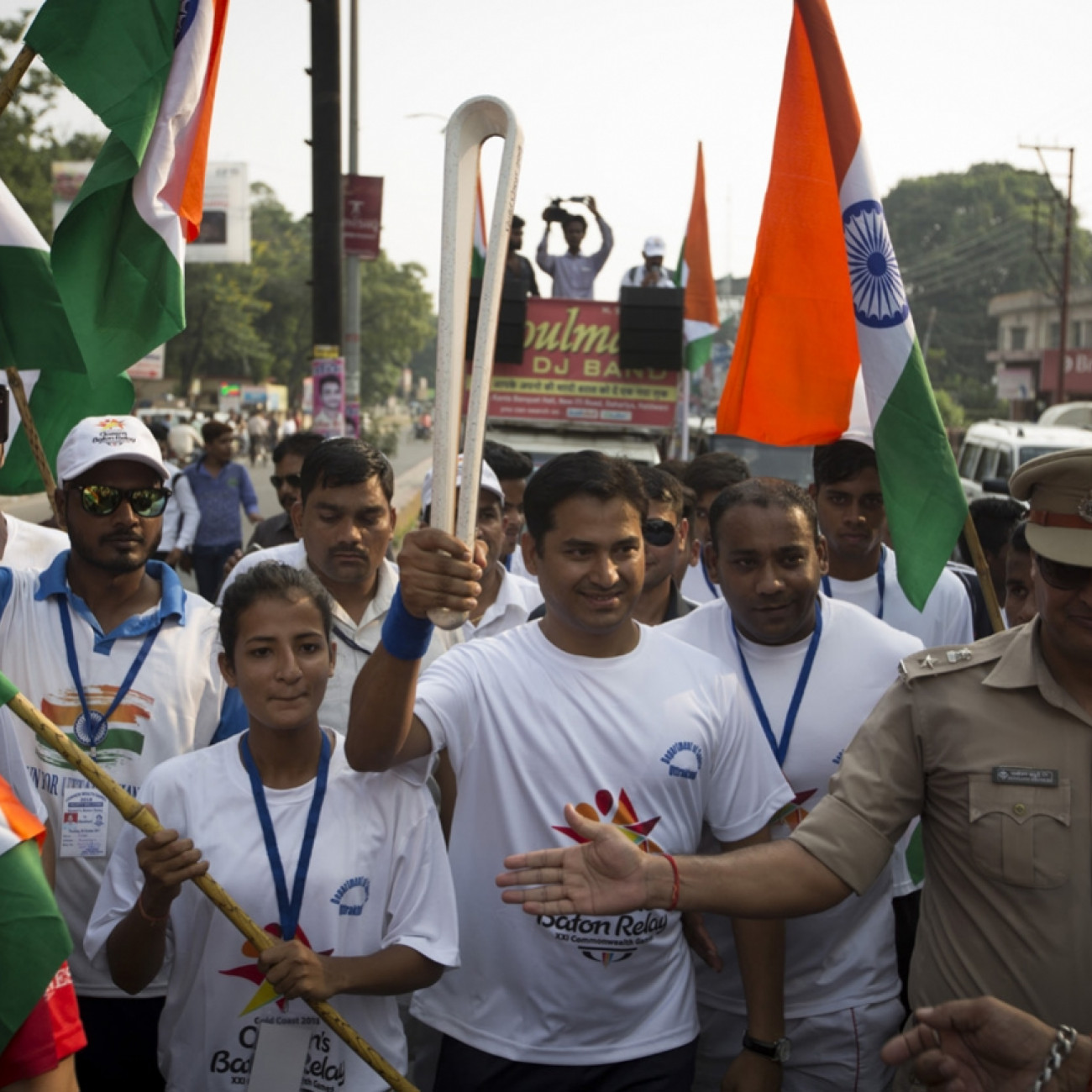 Batonbearers taking part in the Queen's Baton Relay through the streets of Haldwani