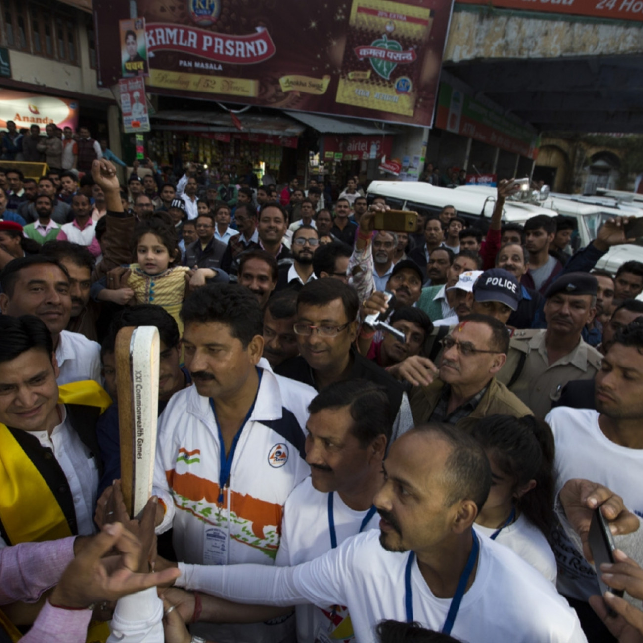Crowds and dignitaries welcoming the Baton to the town of Nainital as the Queen's Baton Relay visited the hill station
