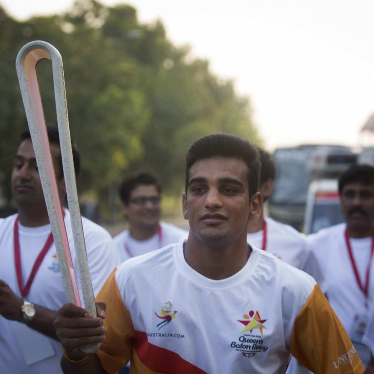 Mandeep Jangra, Glasgow 2014 silver in boxing welterweight carrying the Baton from the National Stadium around the India Gate