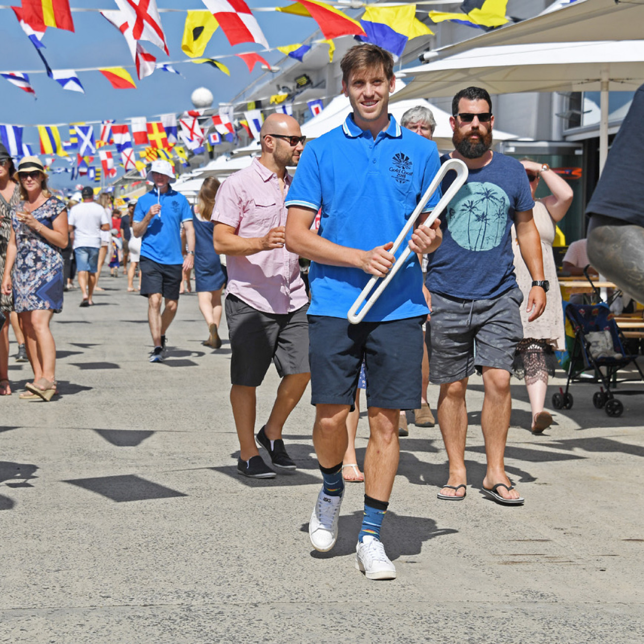 The Queen's Baton and hockey player Eddie Ockenden at the Taste of Tasmania festival