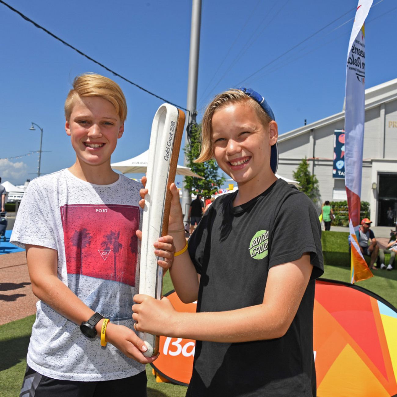Two young kids with the Queen's Baton at Princes Wharf in Hobart