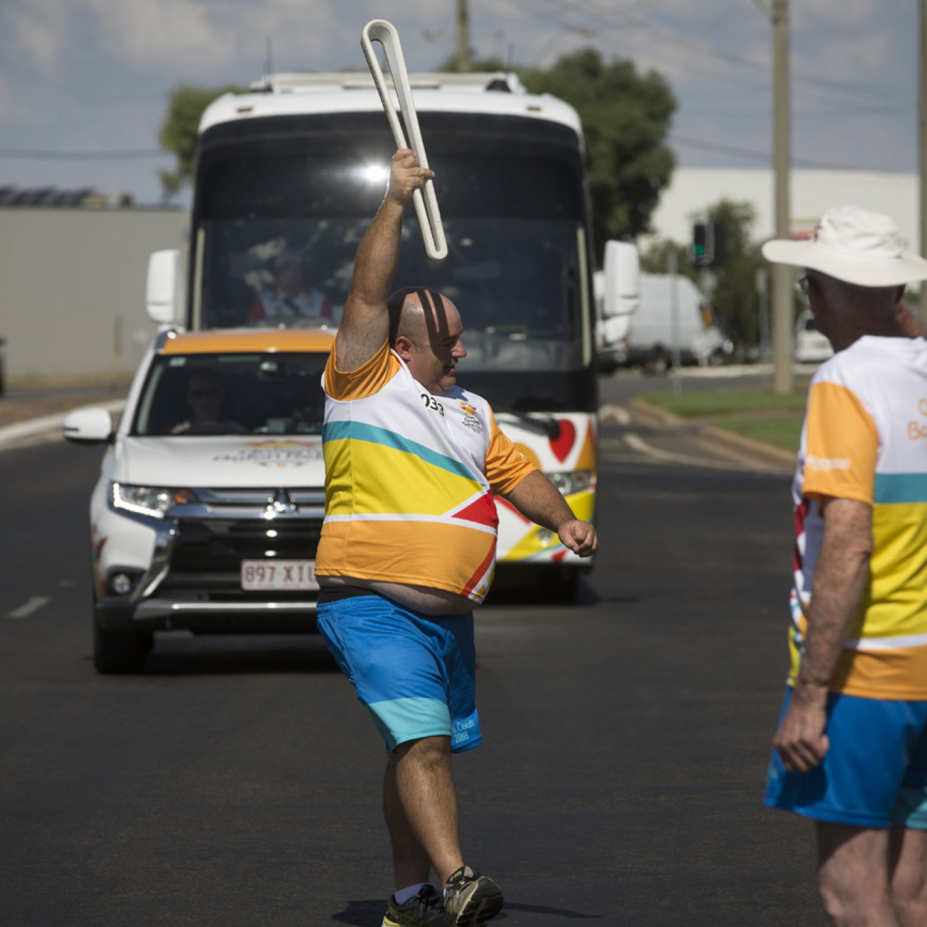 A Batonbearer with the Baton as the Queen's Baton Relay passed through Griffith
