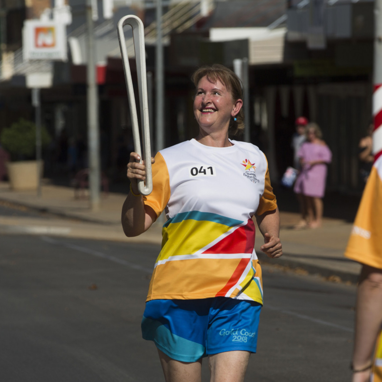 A Batonbearer with the Queen's Baton as the Queen's Baton Relay passed through Griffith