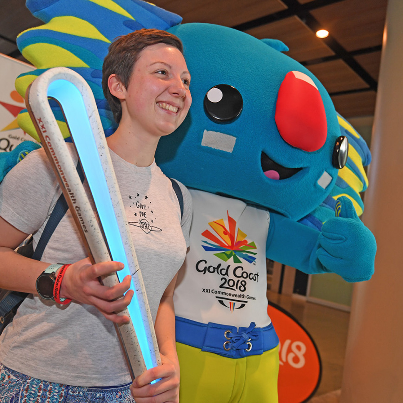 A visitor to the MCG poses with the Queen's Baton and Borobi