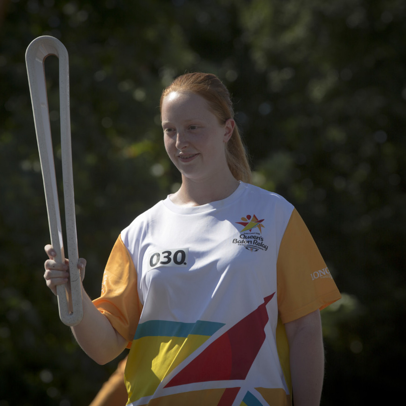 Batonbearer Claire Murray with the Queen's Baton in Griffith