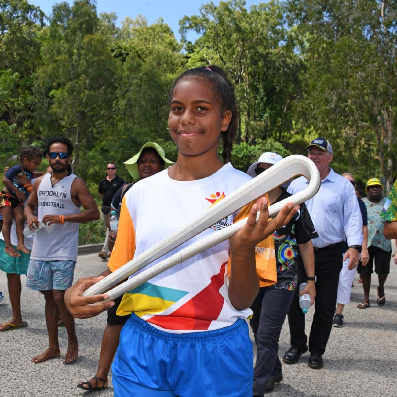 Local schoolgirl Ikanau Conway carrying the Queen's Baton on Palm Island
