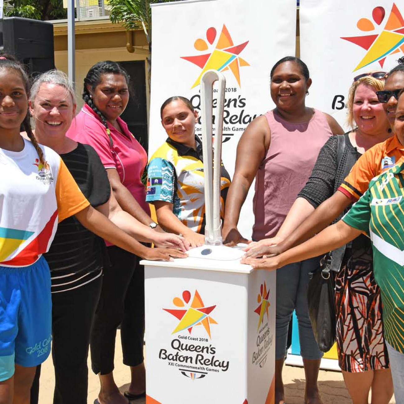 Palm Island locals posing for a photo with the Queen's Baton