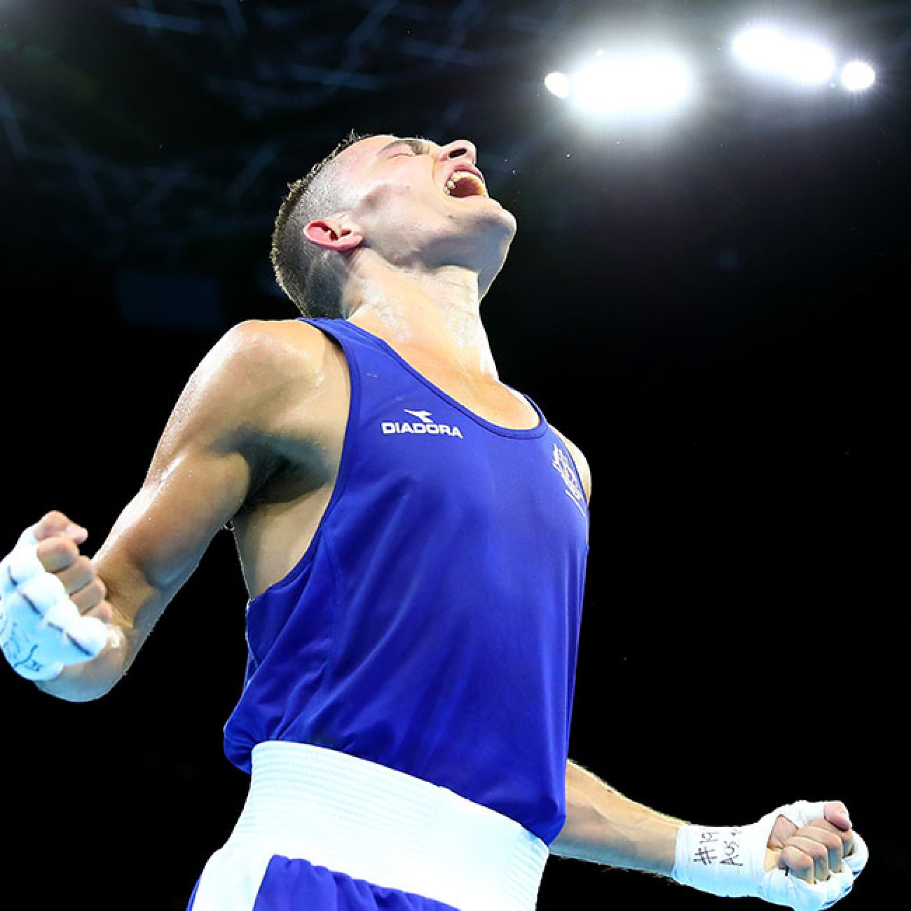 Brendan Irvine of Australia celebrates winning against Gaurav Solanki of India in the men's 52kg final Boxing bout.