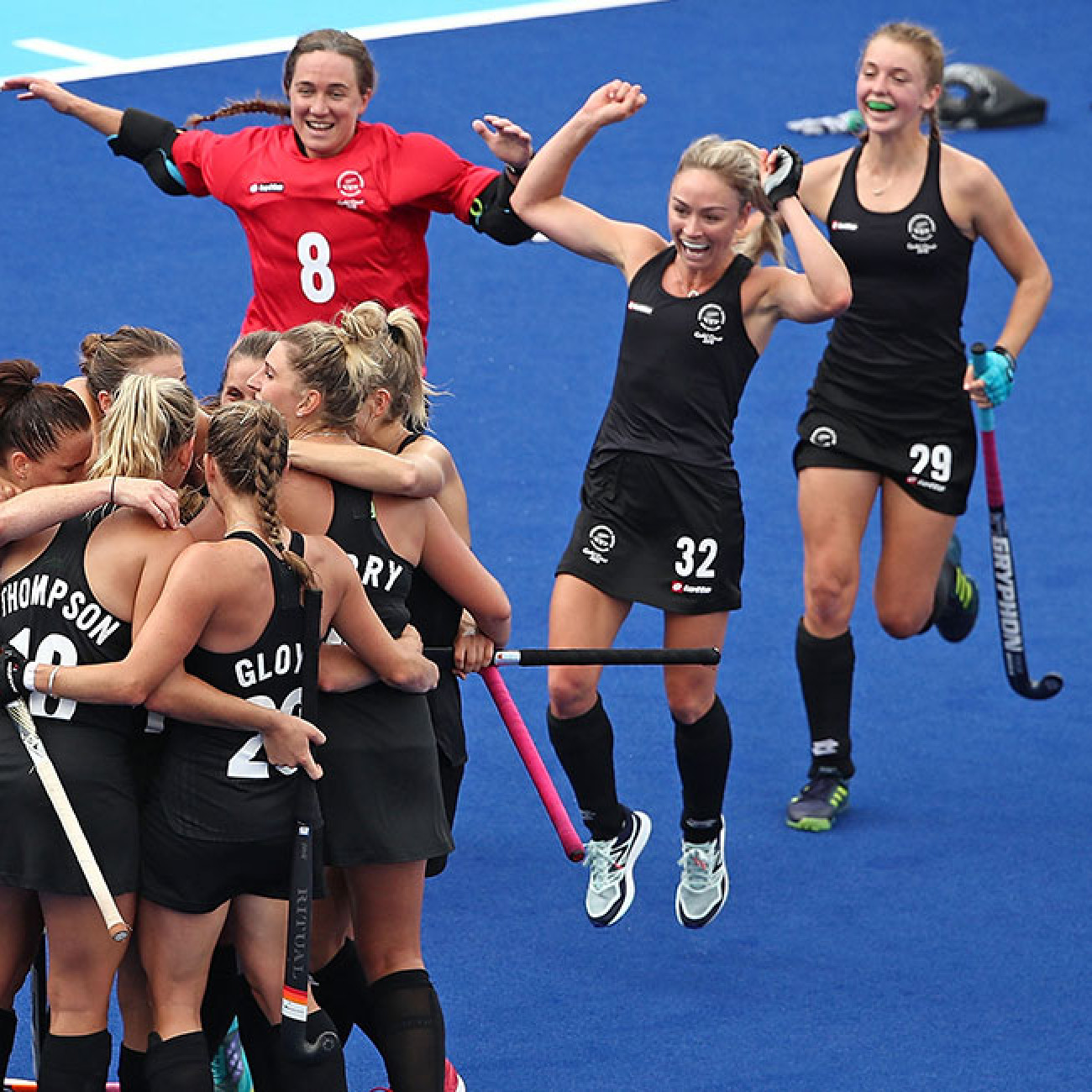 New Zealand celebrate winning at full time during the women's gold medal match against Australia.