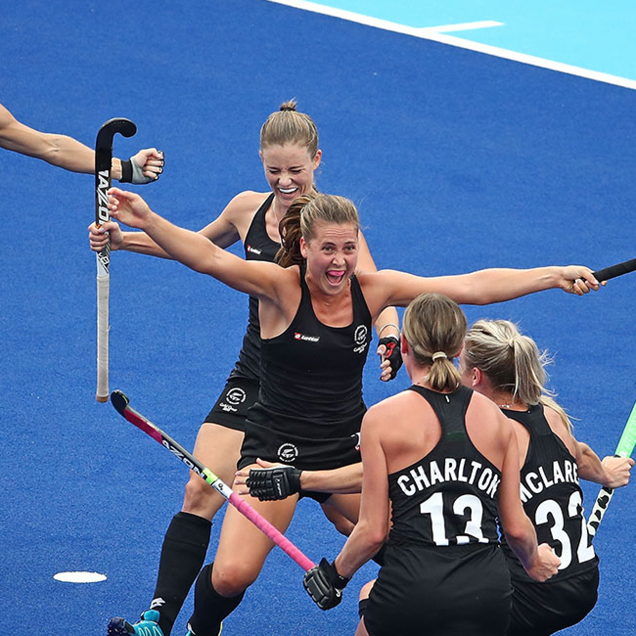 Rose Keddell of New Zealand is congratulated by her teammates after scoring their second goal against Australia.