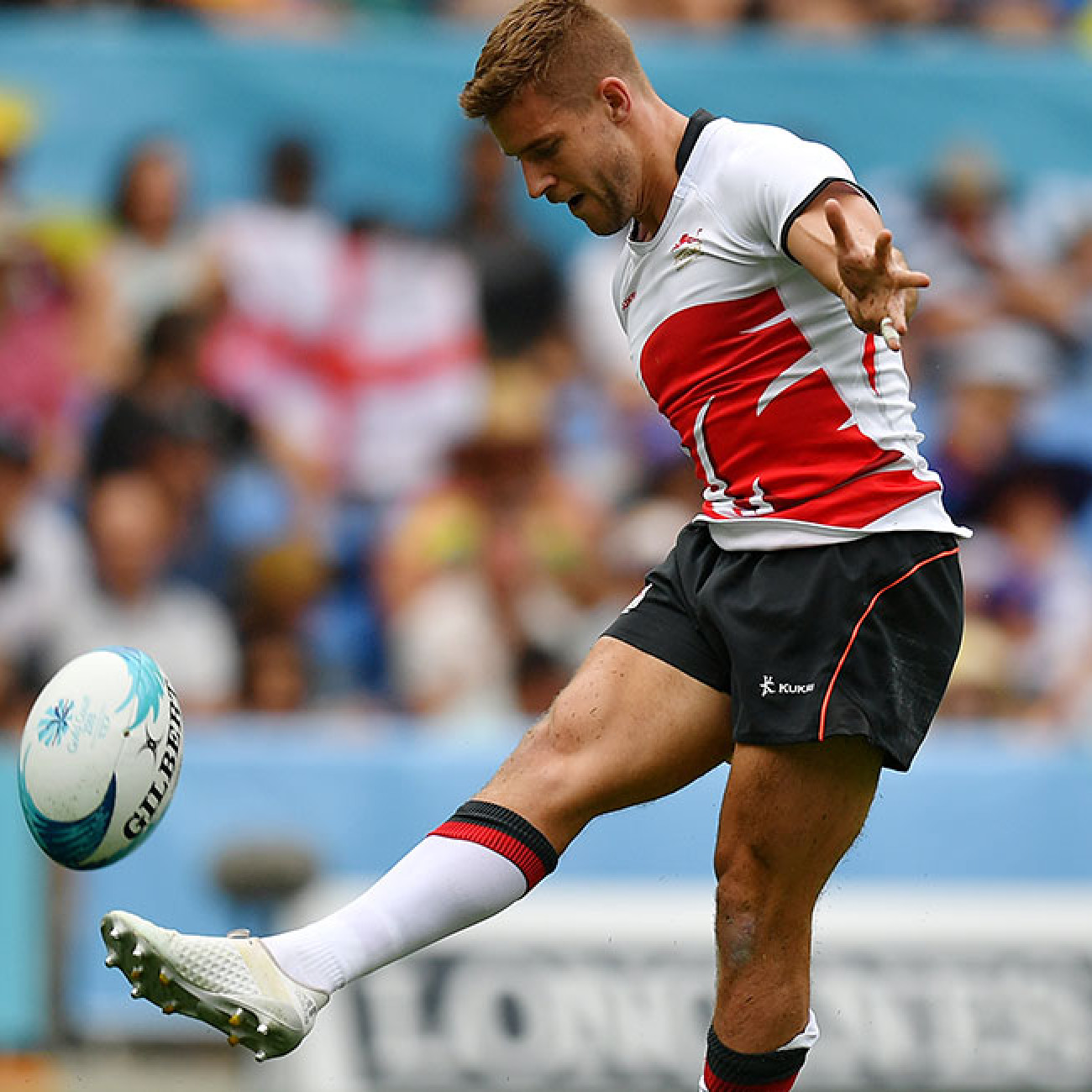 Tom Mitchell of England converts his own try during the Rugby Sevens men's pool B match between England and Jamaica.