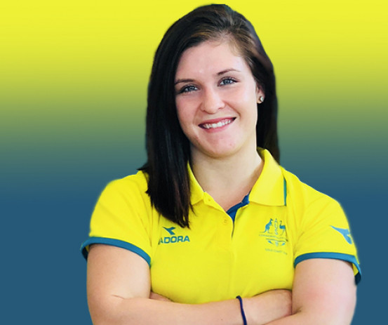 Carissa Holland poses in her Australian wrestling gear after being announced in the Gold Coast 2018 Commonwealth Games team.