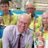 GOLDOC Chairman Peter Beattie and CEO Mark Peters give out Peter's Ice Creams to volunteers.