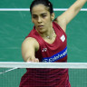 India's Saina Nehwal returns during her quarterfinal women's singles match during the 2017 BWF Championships in Glasgow