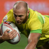 Australian rugby sevens player James Stannard dives for a try at the Sydney Sevens.